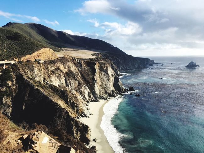 Big Sur CALIFORNIA Bixby Bridge Water Sea Scenics Tranquil Scene Beauty In Nature Horizon Over Water Beach Sky Tranquility Calm Shore Cliff Idyllic Nature High Angle View Coastline Cloud - Sky Cloud Mountain Blue Big Sur California