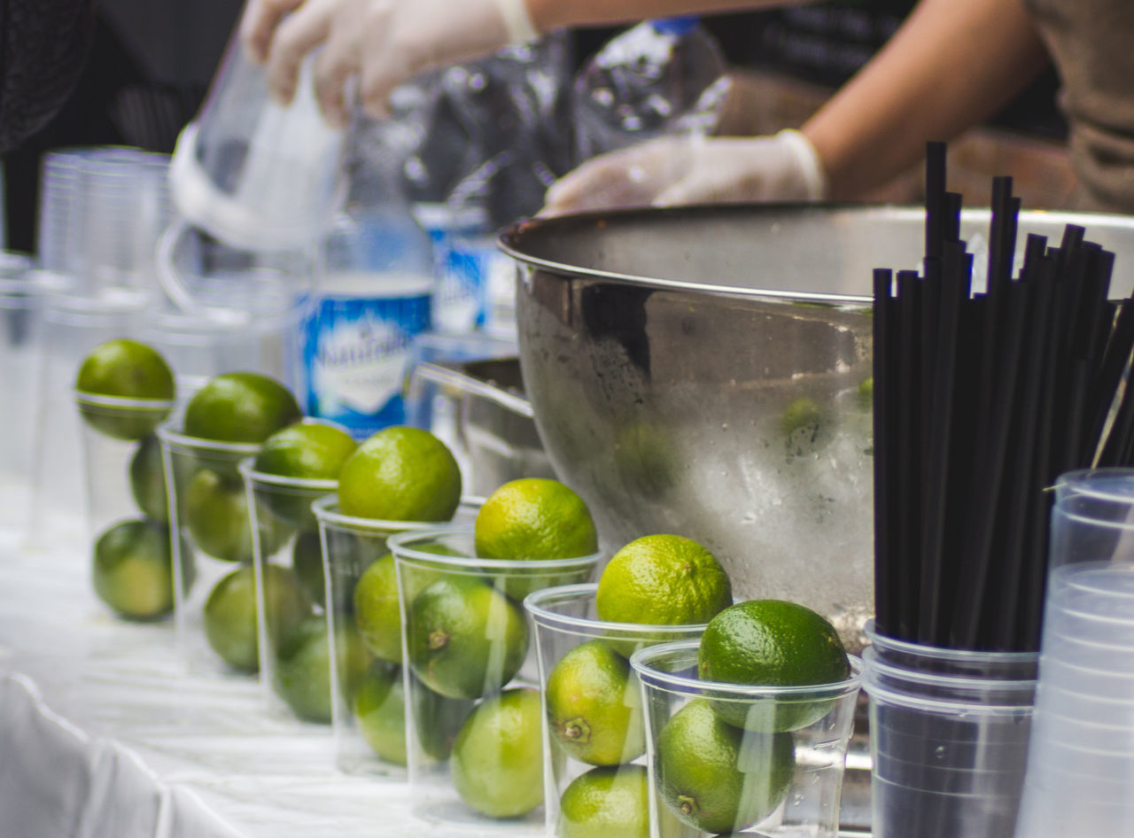 Cocktail Day Festival Food Food And Drink Freshness Fruit Lifestyles Lime Making Music Mojito Part Of Real People Summertime Sunset