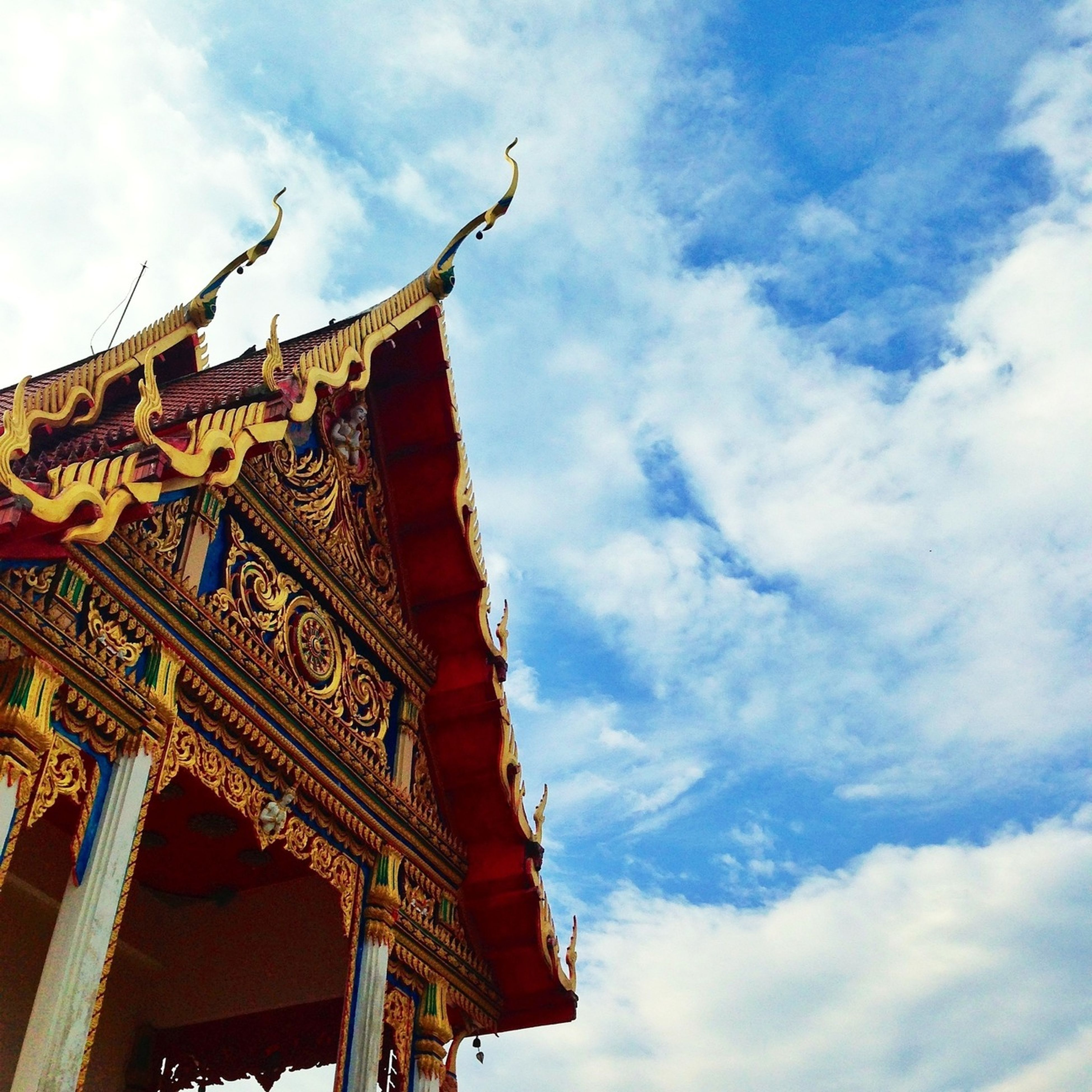 low angle view, architecture, built structure, building exterior, sky, place of worship, religion, spirituality, famous place, cloud - sky, temple - building, travel destinations, history, ornate, cloud, tourism, art and craft, travel, cultures