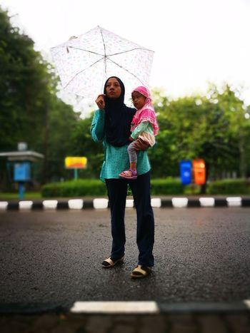 Umbrella mom at Ragunan Zoo
