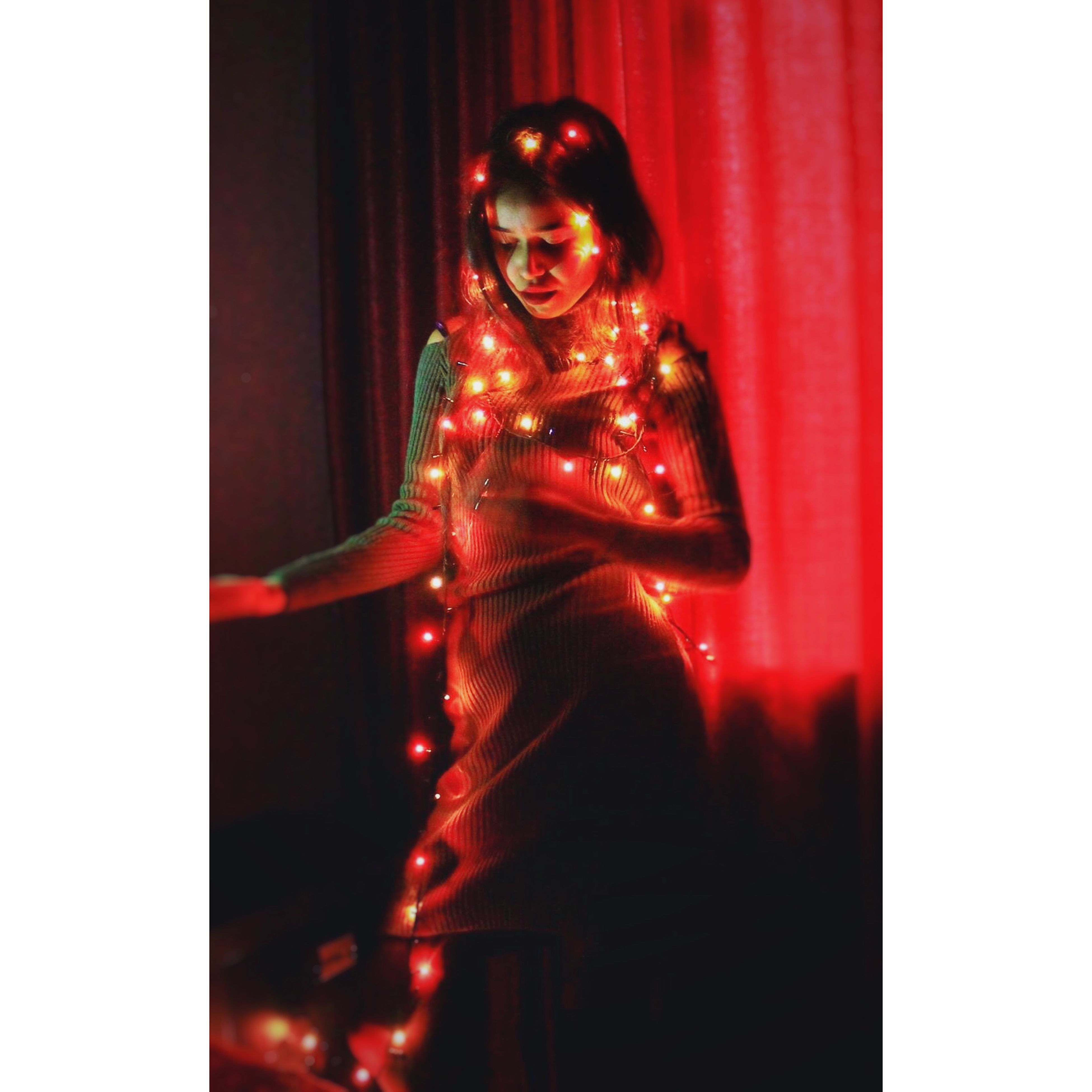 transfer print, auto post production filter, red, front view, young adult, indoors, portrait, person, looking at camera, lifestyles, young women, standing, reflection, leisure activity, three quarter length, holding, human representation, full length