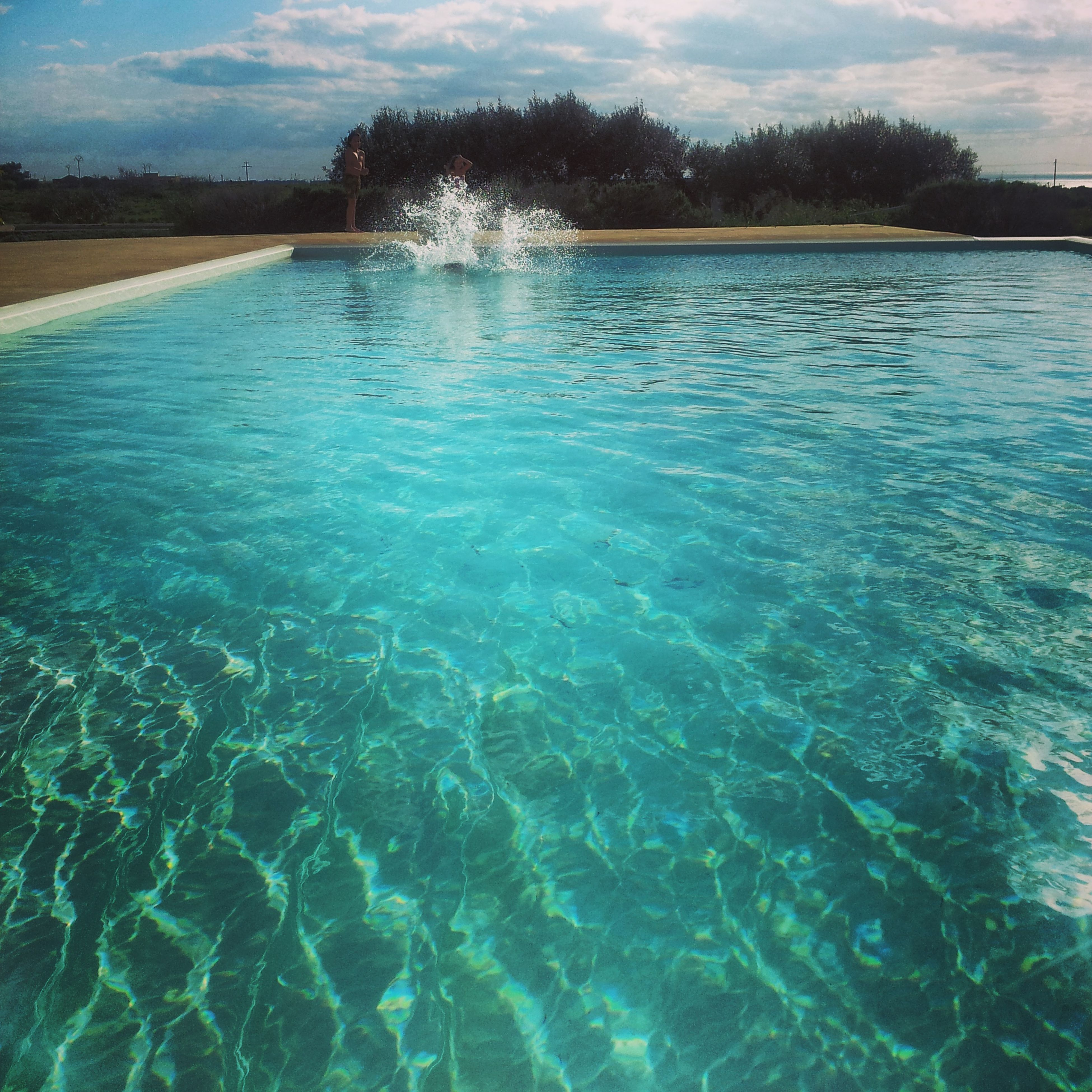 water, rippled, waterfront, blue, sea, sky, reflection, tranquil scene, tranquility, scenics, nature, beauty in nature, tree, sunlight, swimming pool, turquoise colored, idyllic, day, outdoors, no people