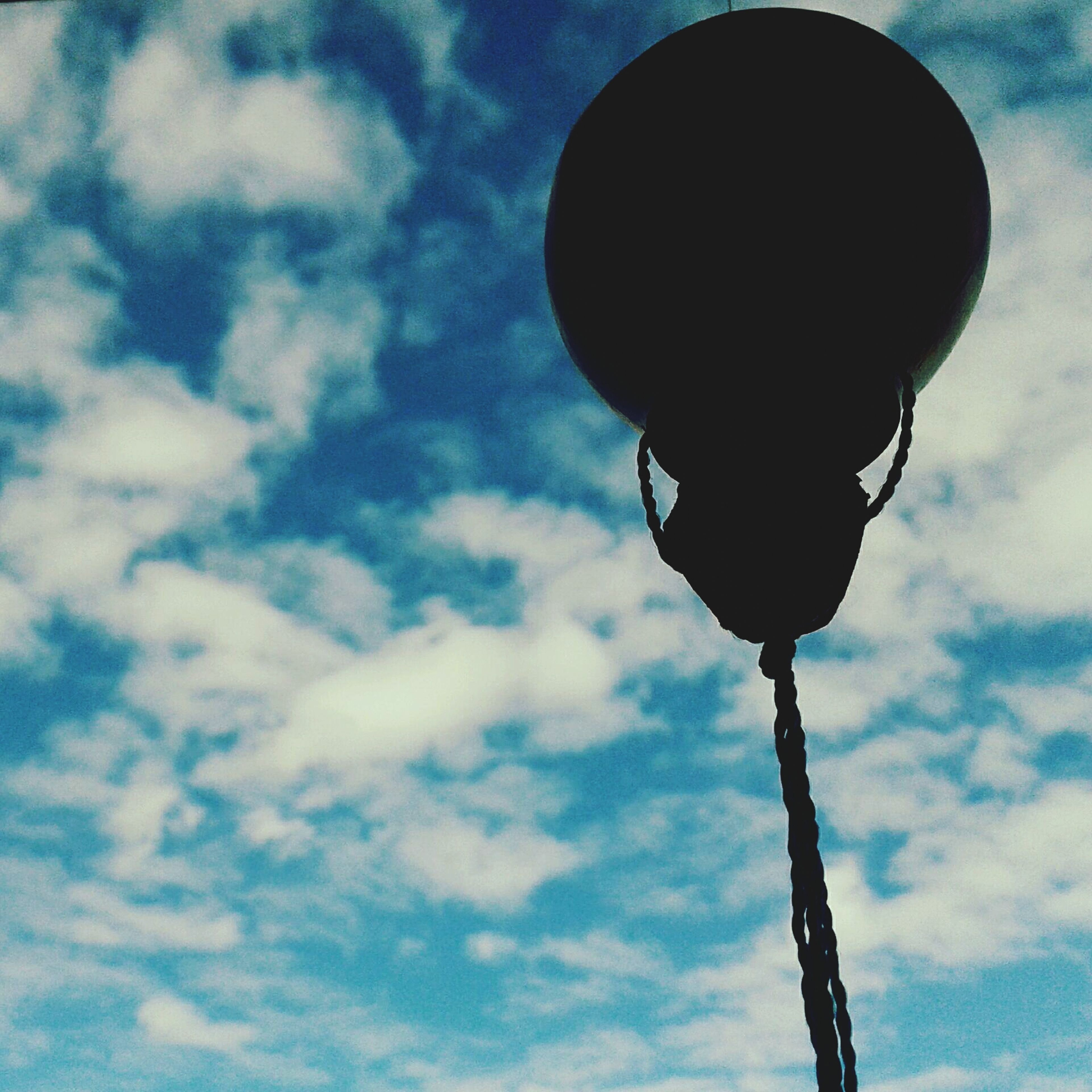 low angle view, sky, street light, lighting equipment, cloud - sky, pole, cloudy, cloud, outdoors, blue, electricity, no people, nature, day, electric light, lamp post, metal, tall - high, tranquility, dusk