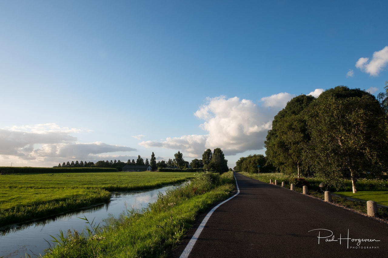 Road towards clouds Beauty In Nature Cloud - Sky Day Farmland Grass Green Color Growth Landscape Mijdrecht Nature No People Outdoors Road Scenics Sky The Way Forward Tranquil Scene Tranquility Tree Water