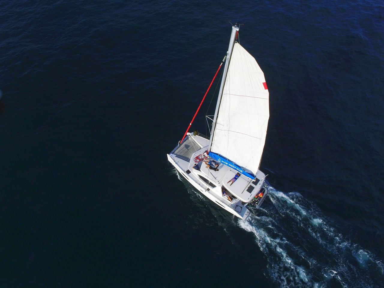 Boat Sailboat Nautical Vessel High Angle View Sailing People Sport Adults Only CompetitionYacht Aerial View Regatta Yachting Adult Day Group Of People Sports Team Vacations Sea Outdoors Crew Wave