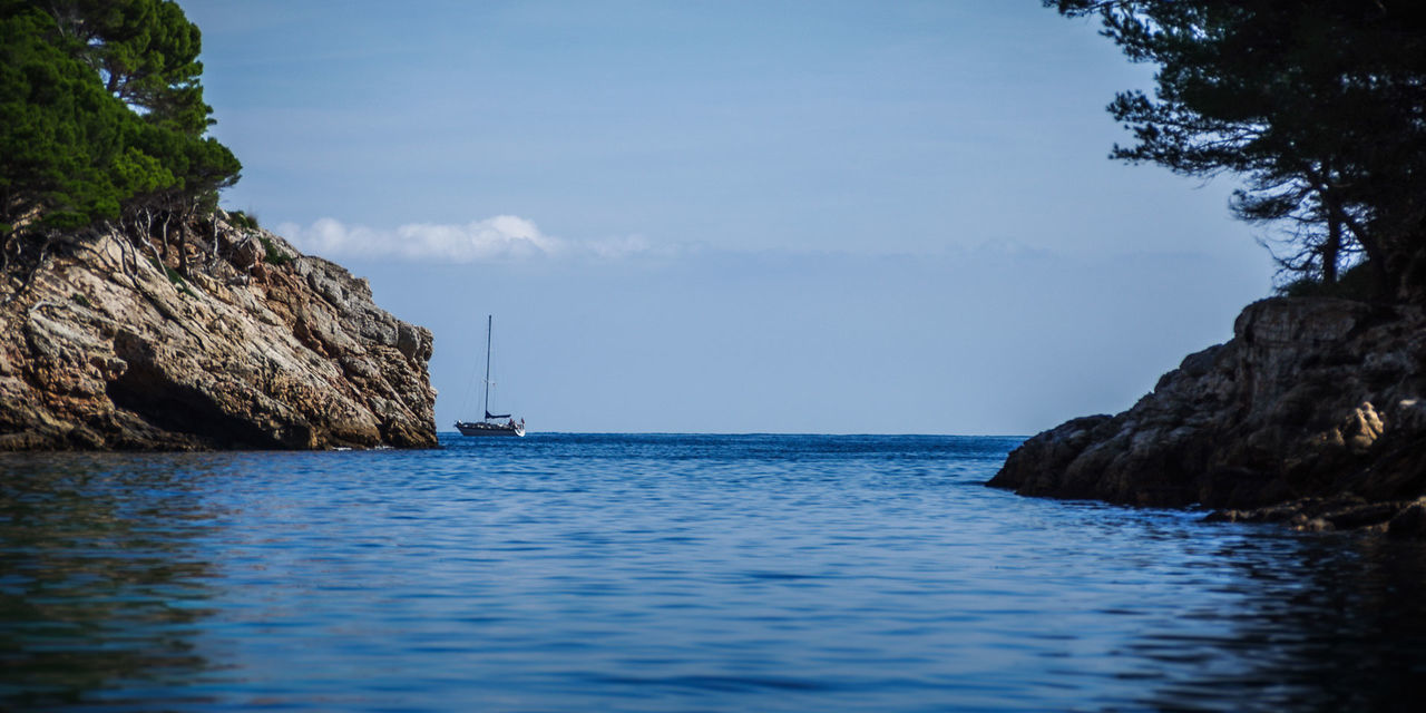 Sailing Boat Leaves Bay... Landscape Water Blue Ocean Ocean View Mallorca SPAIN Boat Sailing Alone No People EyeEm Best Shots Seascape Nature Cliff Sky Horizon Over Water Calm Tranquil Scene My Year My View Trip Holiday