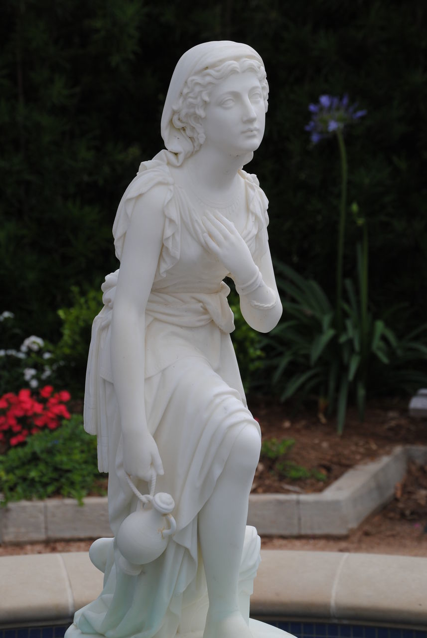 statue, human representation, sculpture, male likeness, art and craft, female likeness, white color, park - man made space, no people, outdoors, flower, tree, day, close-up