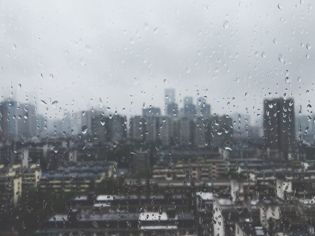 Wet Rain Window Drop Glass - Material Transparent Weather Rainy Season Building Exterior Water City RainDrop Built Structure No People Day Focus On Foreground Close-up Sky Indoors