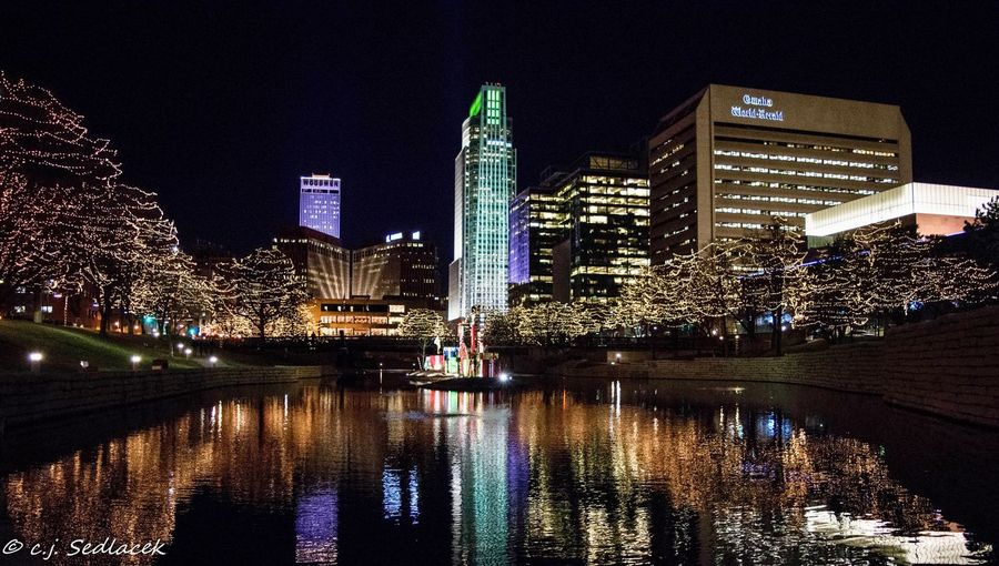 Night Illuminated Architecture Building Exterior Built Structure Skyscraper Reflection Modern City Water Waterfront Cityscape Sky Outdoors Urban Skyline Travel Destinations No People Omaha, Nebraska Christmas Lights Christmastime Nebraska Omaha Photographer Downtown District Downtown Gene Leahy Mall