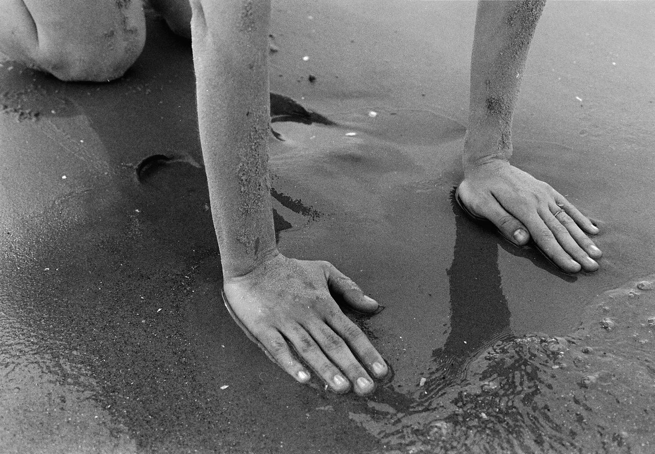 The Island Abdomen Adult Adults Only Analog Analogue Photography Baltic Baltic Sea Barefoot Blackandwhite Close-up Day Human Body Part Human Hand Lifestyles Low Section Men One Person Outdoors People People Photography Real People Sand She Water Womanity