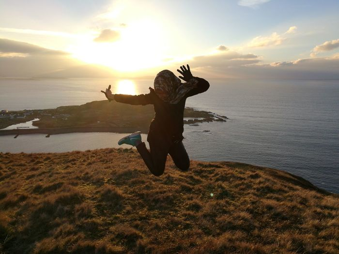 Hi! I just want to share the beauty of Scotland that I have the opportunity to enjoy while I'm studying here :) welcome to my profile and opinions are highly appreciated :) ellenabeich Isle Of Seil Scotland Highlands Of Scotland Sunset Cliffs Sea And Sky Jump Hijabgirl Hijabers_indonesia Hijabi