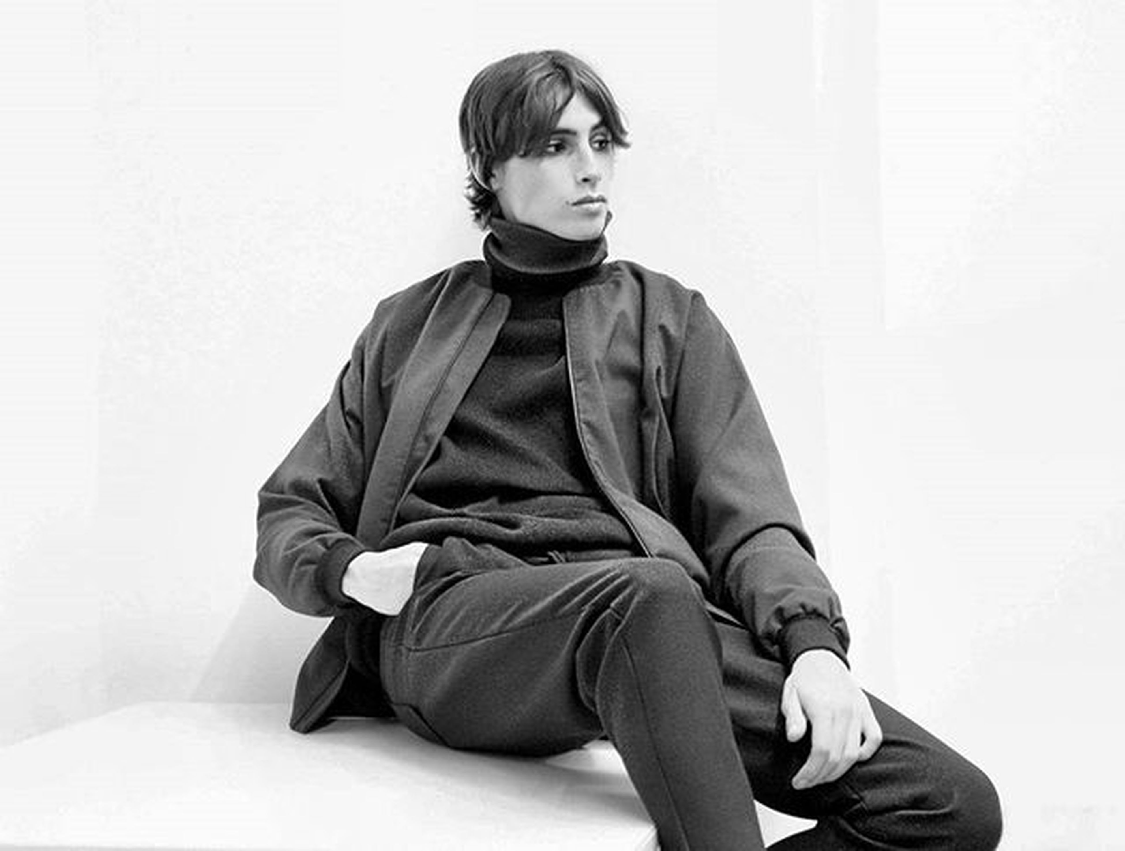 casual clothing, person, lifestyles, three quarter length, young adult, indoors, front view, full length, leisure activity, standing, sitting, young men, wall - building feature, portrait, side view, looking at camera, holding