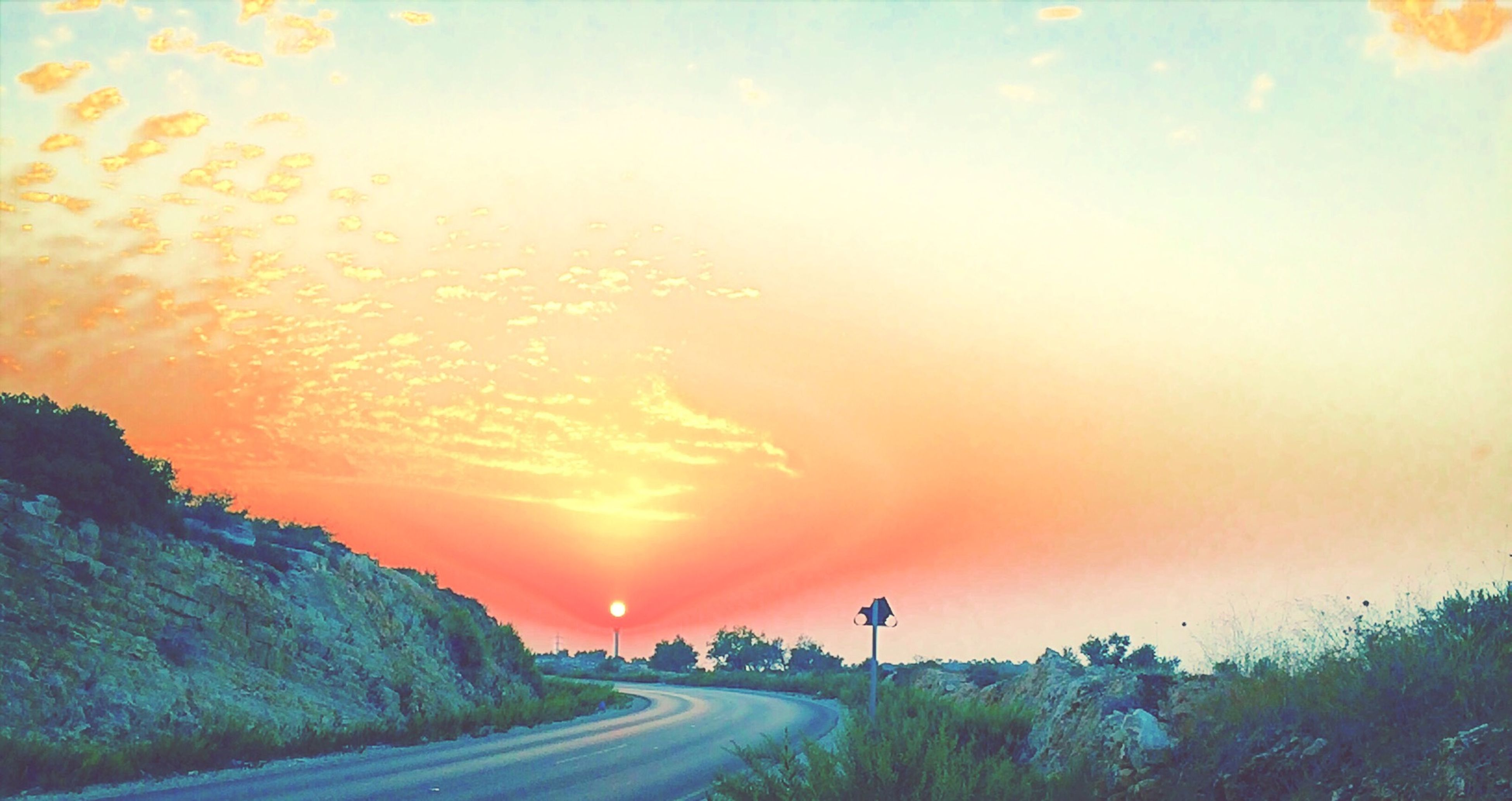 sunset, orange color, sun, sky, scenics, beauty in nature, nature, tranquility, the way forward, road, tranquil scene, cloud - sky, sunbeam, idyllic, sunlight, transportation, water, tree, diminishing perspective, landscape