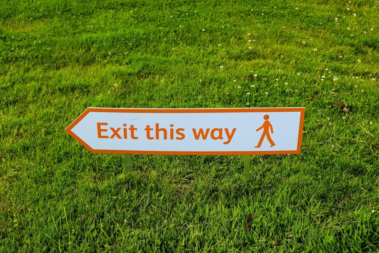 Close-up Communication Day Exit Sign Grass Green Color Growth Nature No People Outdoors Sign Signage Text