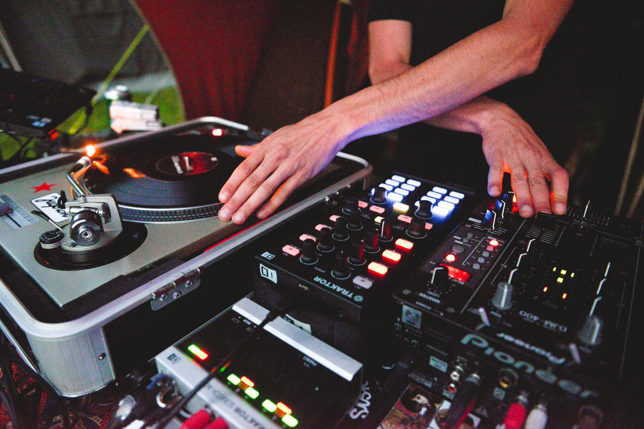 Arts Culture And Entertainment Bottoms Close-up Cropped Dj Dj Set Focus On Foreground Leisure Activity Lifestyles Music Music Festival Music Is My Life Musician Open Air Part Of Scratching Selective Focus Summer Summer Gathering Technics Technics 1200 The Innovator The Mix Up Vinyl Vinyl Records