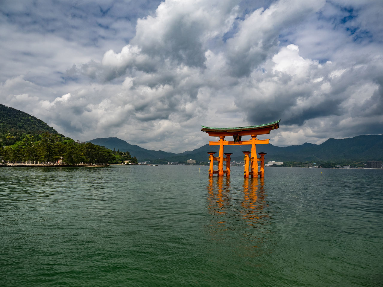 The holy arch, and gate way to the sacred island. Arch Beauty In Nature Blue Cloud Holy Island Japan Landscape Miyajima Nature No People Non-urban Scene Outdoors Overcast Remote Sacred Scenery Scenics Sky Tranquil Scene Travel Destinations Ultimate Japan Water Waterfront Weather