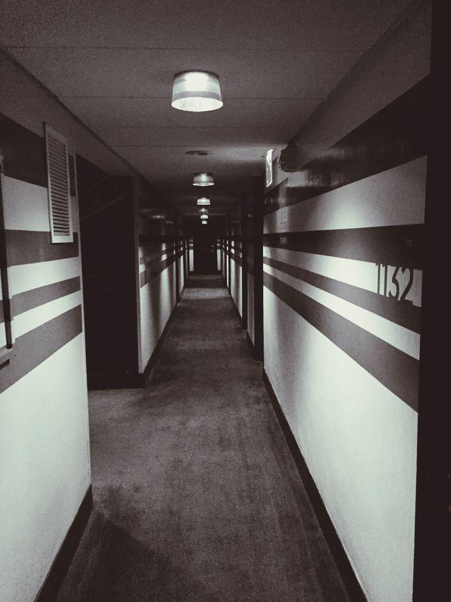 Going down Hallway Hotel Doors Corridor Blackandwhite