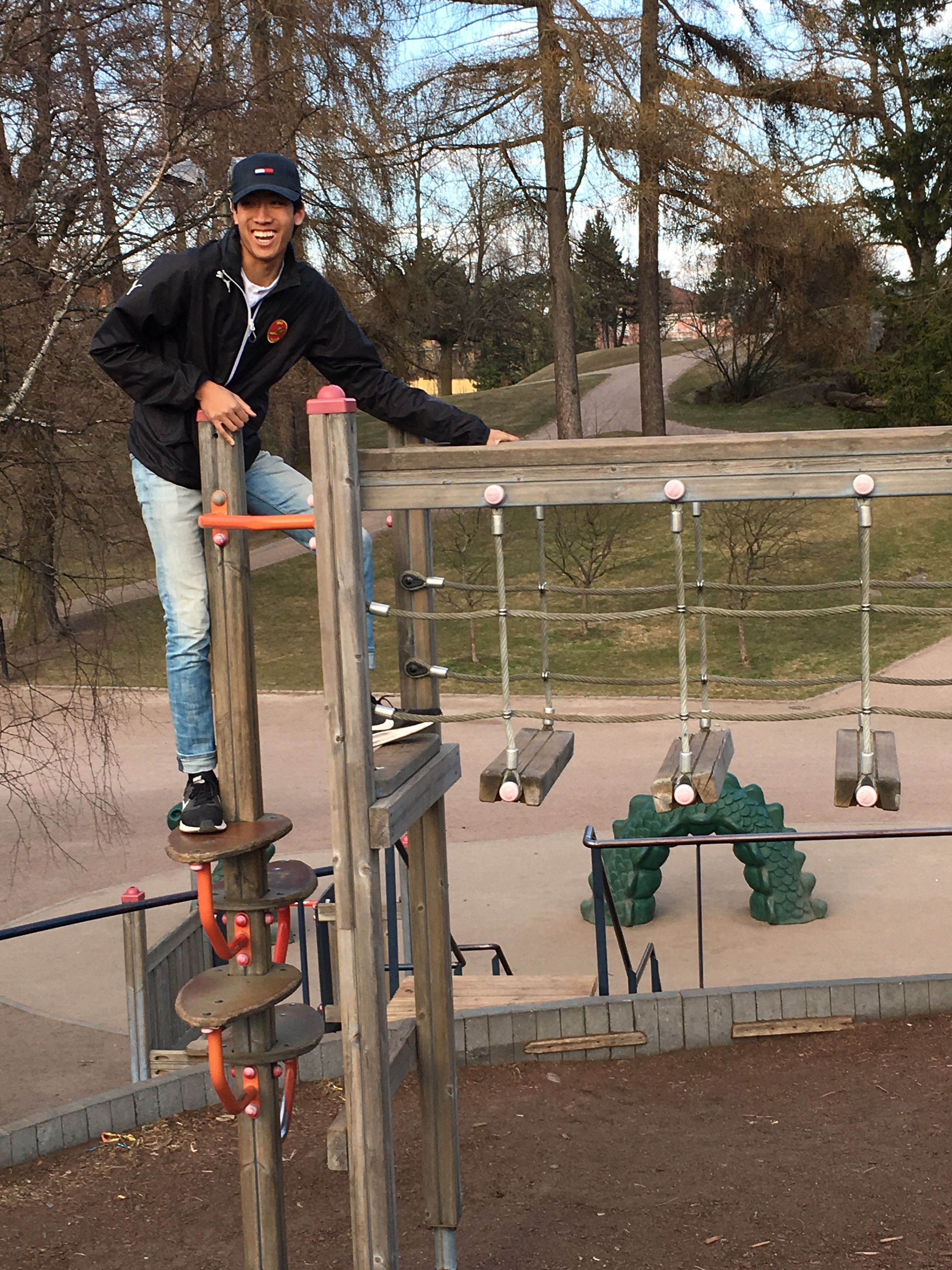full length, teenager, tree, railing, one person, leisure activity, day, casual clothing, outdoors, lifestyles, standing, sport, real people, skill, skateboard park, people, adult