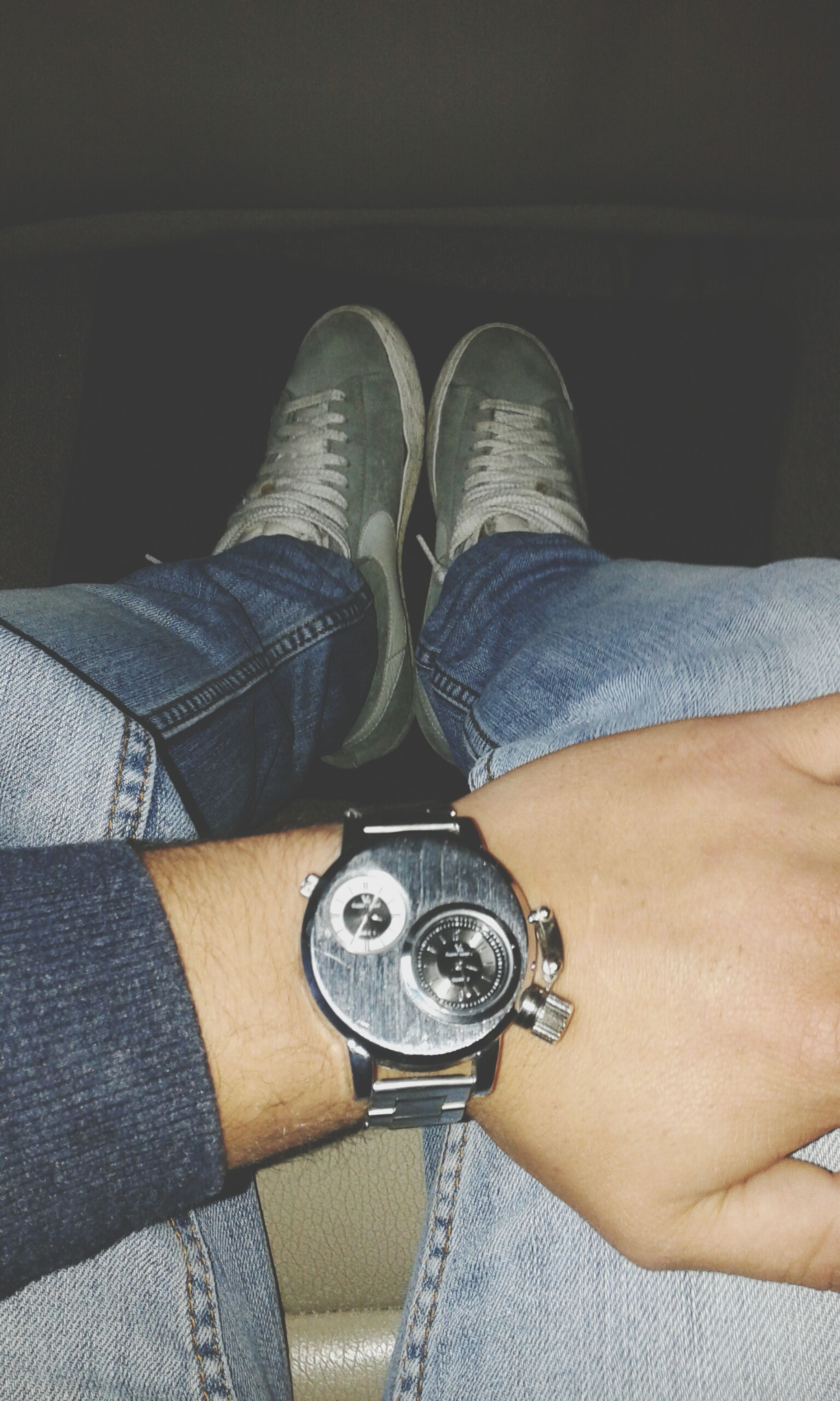 low section, person, lifestyles, shoe, leisure activity, men, jeans, personal perspective, casual clothing, sitting, footwear, human foot, part of, standing, high angle view, fashion