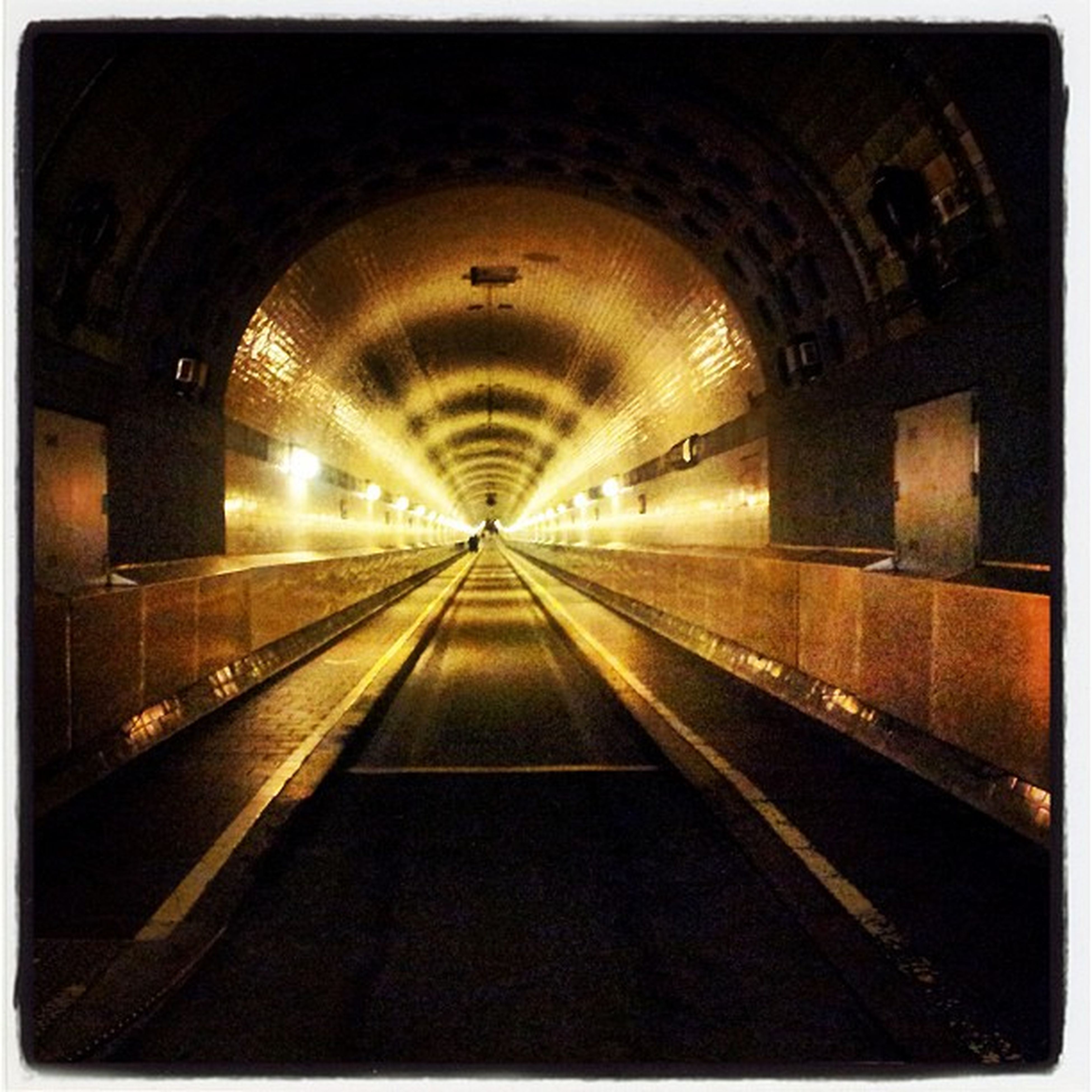 transfer print, the way forward, transportation, diminishing perspective, auto post production filter, indoors, vanishing point, tunnel, illuminated, railroad track, architecture, built structure, arch, rail transportation, travel, empty, railroad station, public transportation, no people, road