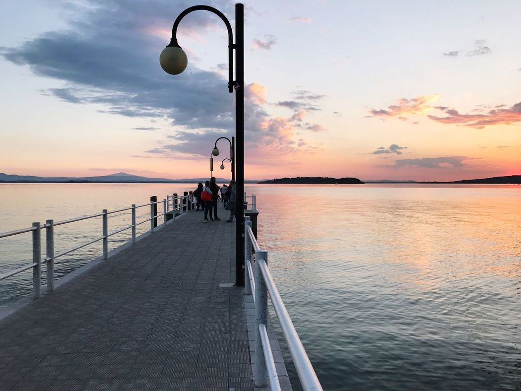 Trasimenolake Pier Lake Water Sky Sunset Nautical Vessel Nature Outdoors Cloud - Sky Horizon Over Water Real People Scenics Day Built Structure Waterfront Lake View Calm Tranquil Scene Tranquility Umbria Trasimeno Beauty In Nature Sunset And Clouds  Orange Sky Gridlove