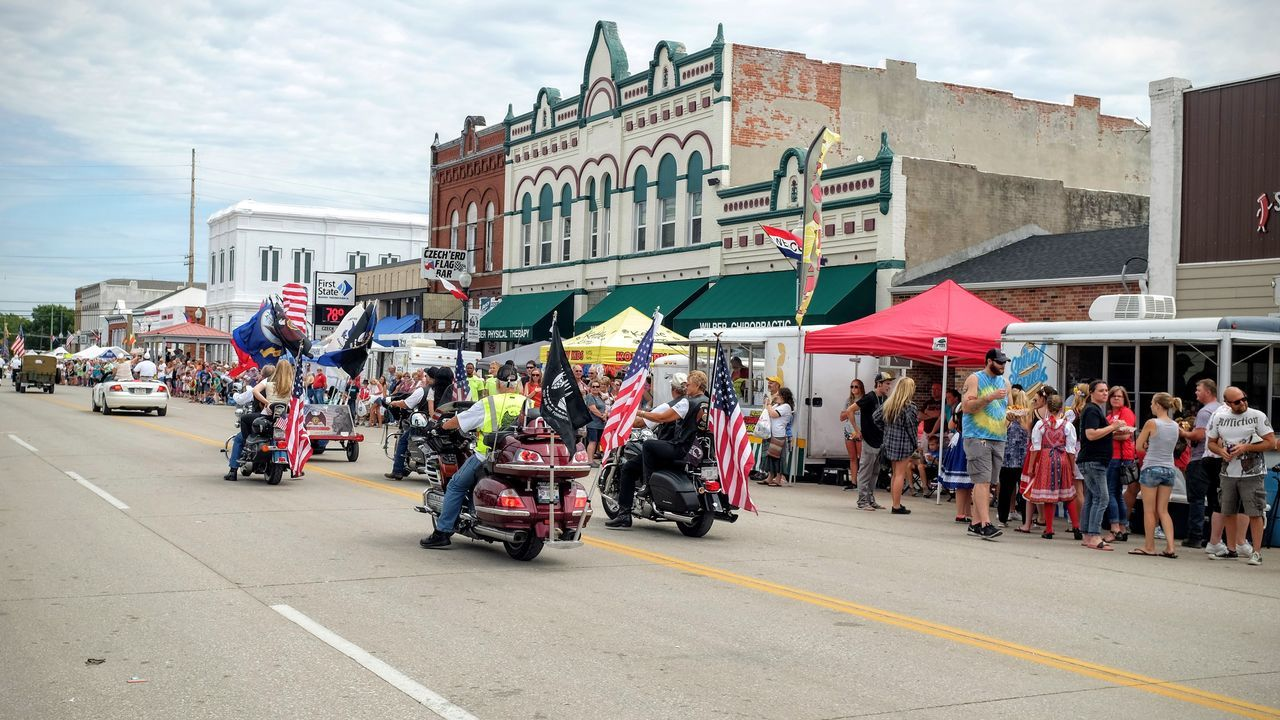 55th Annual National Czech Festival August 5, 2016 Wilber, Nebraska Architecture City City Life Color Photography Czech Days Czech Festival Day Event Flags Large Group Of People Lifestyles Main Street USA Midday Sunlight Motorcycles Multi Colored Nebraska Outdoors Parade Road Smal Town USA Small Town USA Street Wilber, Nebraska