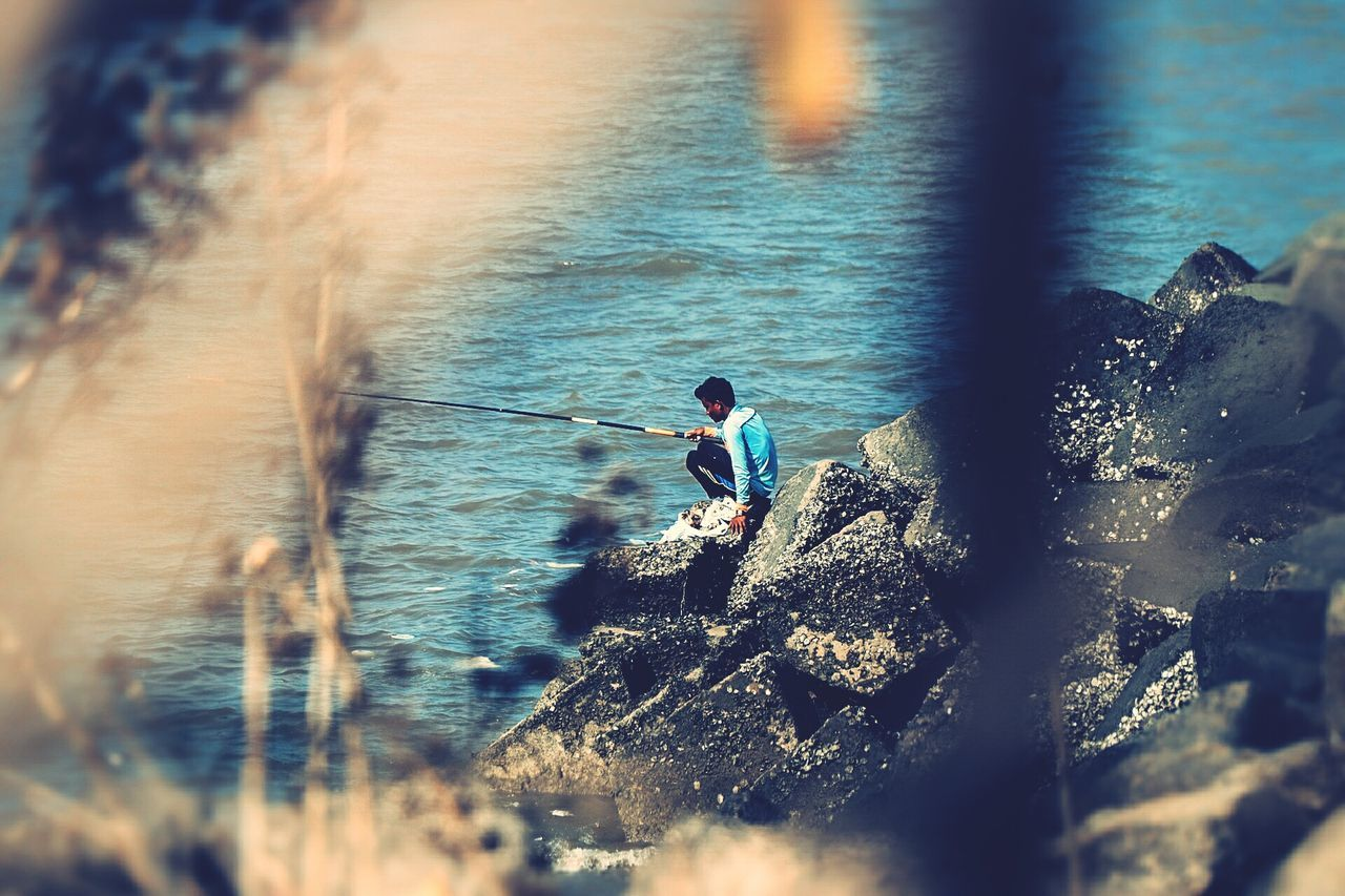 Fishing on a sunny day Fishing Sea Surfing Aquatic Sport Nature Only Men Extreme Sports Ironeyephotography Art Is Everywhere Sunset_collection Occupation Leisure Activity Outdoors One Man Only Real People Sport Water Day Paddleboarding Competitive Sport One Person Adult Adventure Men Oar