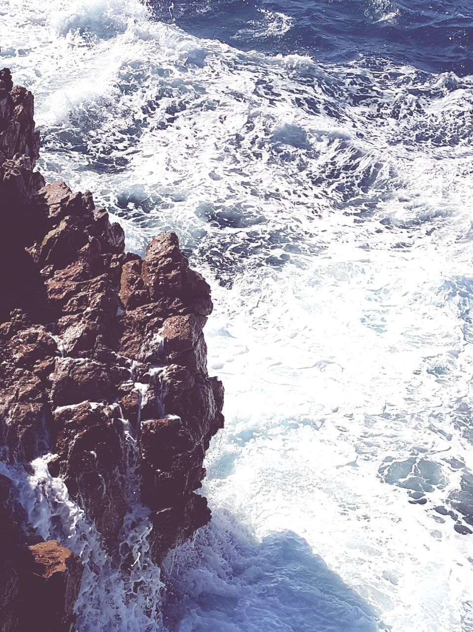 sea, wave, surf, nature, beauty in nature, water, rock - object, no people, high angle view, day, outdoors, motion, scenics, sunlight, power in nature, crash, beach, force