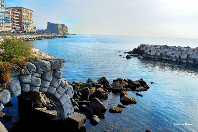 Everything is blue in Naples. Sea Water Horizon Over Water Rock - Object Scenics Tranquil Scene Tranquility Beach Rock Formation Shore Sky Cliff Nature Beauty In Nature Calm Coastline Rock Outdoors Blue Naples, Italy Sunset Casteldellovo