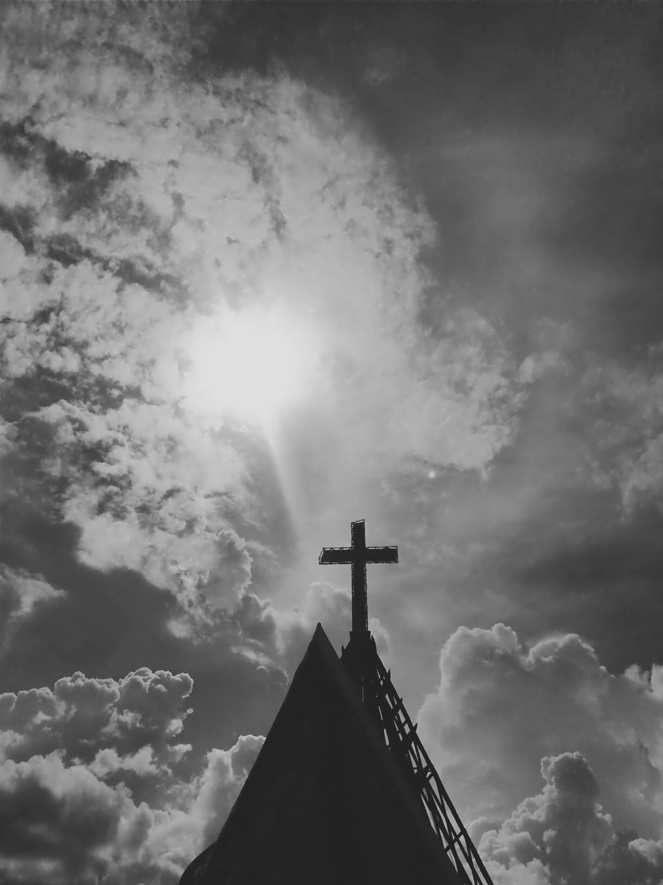Low Angle View Of Building And Cross Against Cloudy Sky