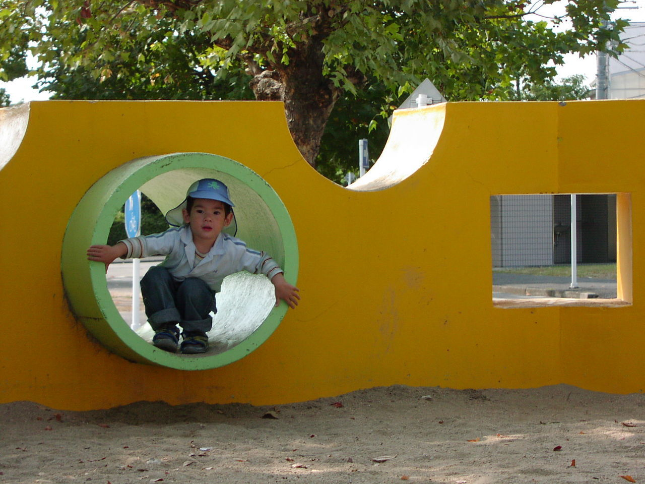 Child's play Front View Happy Kid Having Fun One Child Outdoors Park Peeping Through Play Playground Playground Fun Playgrounds Playing Slide - Play Equipment ın The Park