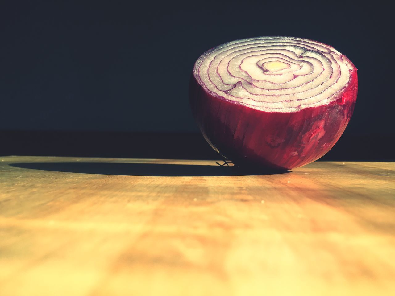 Close-Up Of Onion On Cutting Board