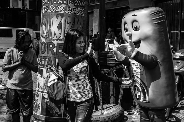 People Outdoors Day Urban Scene Eyeem Philippines People Photography Urban Lifestyle Streetphotography Street Photography Light And Shadow Classic Style Black And White Photography Monochrome Photography Documentary Photo Hand Gestures Mascot