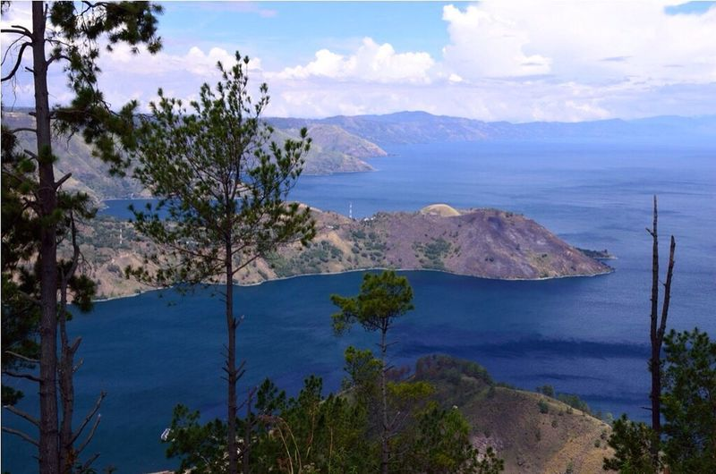 Beauty In Nature Blue Cloud - Sky Distant High Angle View Island Lake Toba Mountain Mountain Range Nature Remote Scenics Sky Toba Toba Lake Tourism Tranquil Scene Travel Destinations Tree Tropical Climate Vacations Water