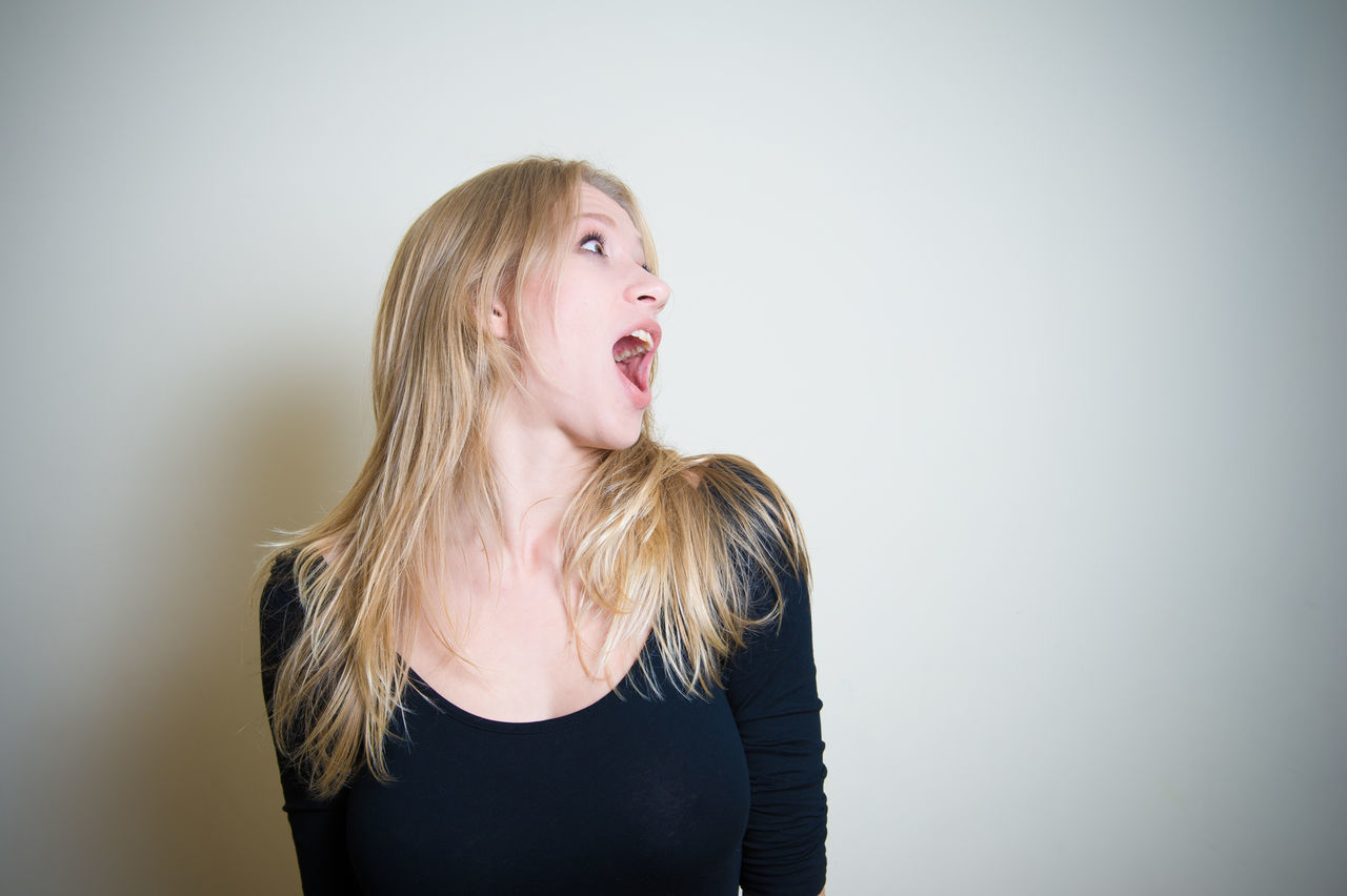 Young woman screaming shocked face expression portrait Adult Adults Only Amazed Astonished Beautiful Copy Space Crying Expression Human Expression Human Face One Person One Woman Only One Young Woman Only Only Women Open Mouth People Portrait Screaming Shock Shocked White Background Woman Young Young Adult