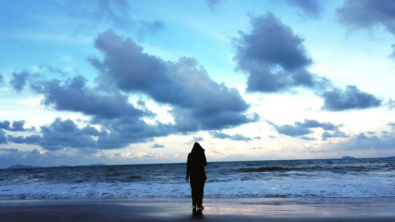 sea, sky, one person, horizon over water, beauty in nature, nature, standing, cloud - sky, beach, water, scenics, real people, silhouette, tranquil scene, leisure activity, tranquility, outdoors, women, lifestyles, wave, day, full length, one woman only, adult, people