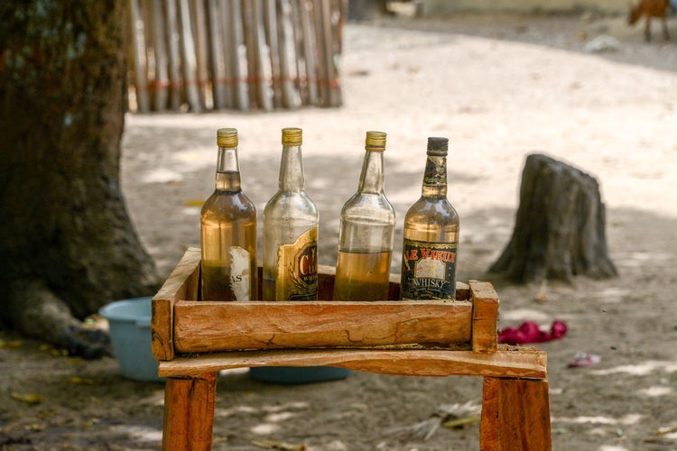 Bottles with gasoline for sale in Senegal Fuel Gasoline Niafarang Niafourang Niafrang West Africa Africa Alcohol Barrel Bottle Casamance Close-up Day Drink Food And Drink Fuel Station No People Outdoors Senegal Table Wine Wood - Material