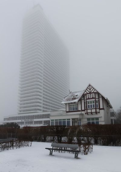 View in the fog Beach Beauty In Nature Bench Cloudy Focus On Foreground Germany High Rise Building Old Buildings Snow Travemünde White
