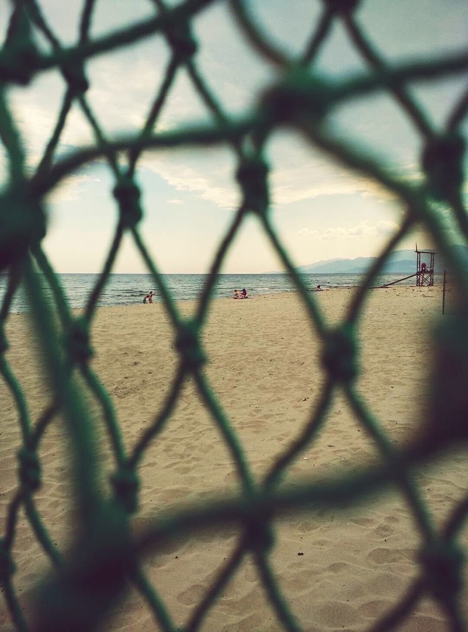 Through The Net Summer Beach Beachphotography Net Green Net Sneak Peek Point Of View Different Perspective The Secret Spaces