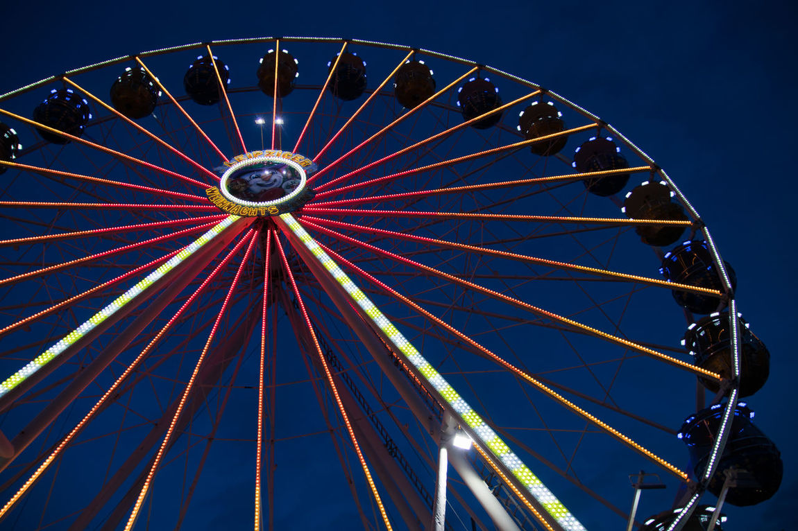 Amusement Park Amusement Park Ride Arts Culture And Entertainment Big Wheel Blue Carousel Circle Clear Sky Ferris Wheel Illuminated Leisure Activity Low Angle View Night No People Outdoors Sky