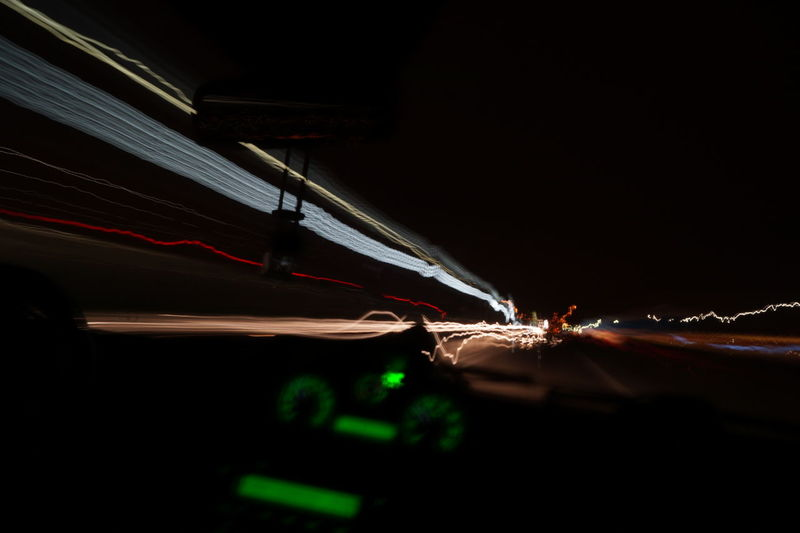 Capturing Motion Night Speed Shining Path Colorful Contrails Car Passenger View Prospective Flame Saturdaynight Moments On The Road Traveling Trip Flicker Eyem Night Illuminated Business Finance And Industry Horizontal No People Indoors