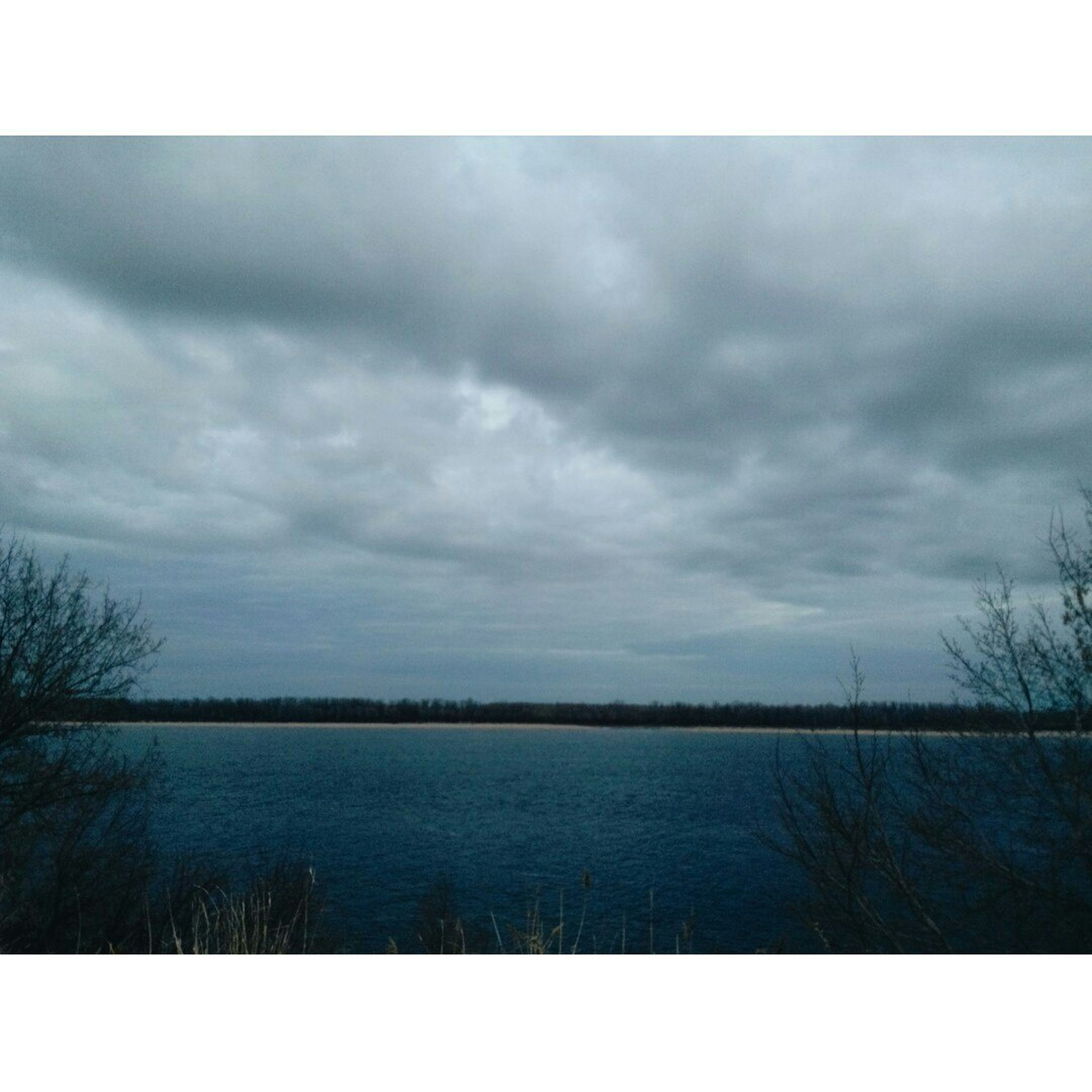 transfer print, sky, tranquil scene, cloud - sky, tranquility, auto post production filter, scenics, water, cloudy, beauty in nature, nature, tree, weather, lake, bare tree, cloud, landscape, overcast, river, outdoors