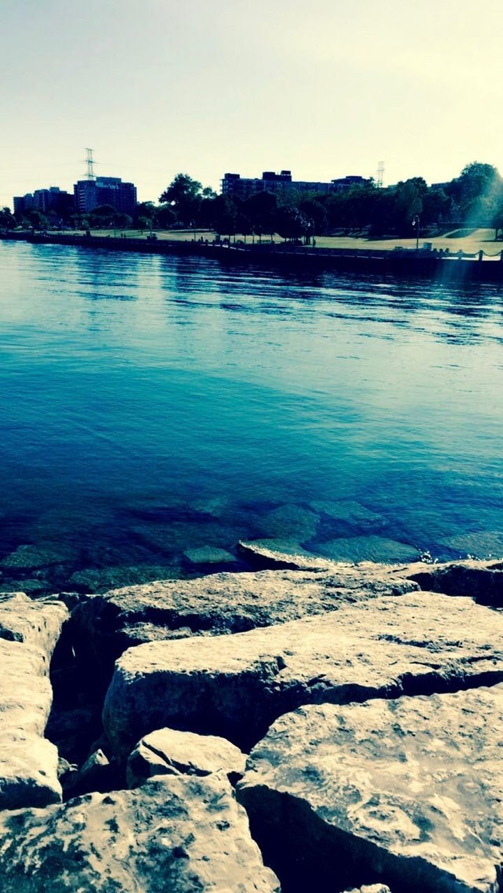 water, nature, tranquil scene, tranquility, outdoors, beauty in nature, rock - object, scenics, no people, day, lake, sky, tree