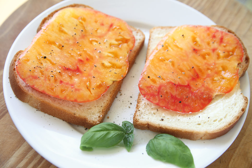 Sandwich of fresh heirloom tomato Basil Leaves Black Pepper Bread Close-up Delicious Dinner Food Healthy Eating Heirloom Tomatoes Juicy Lunch Meal No People Overhead Plate Ready-to-eat Sandwich Serving Size Slices Snack Vegan Food Vegetables Vegetarian Yellow-orange