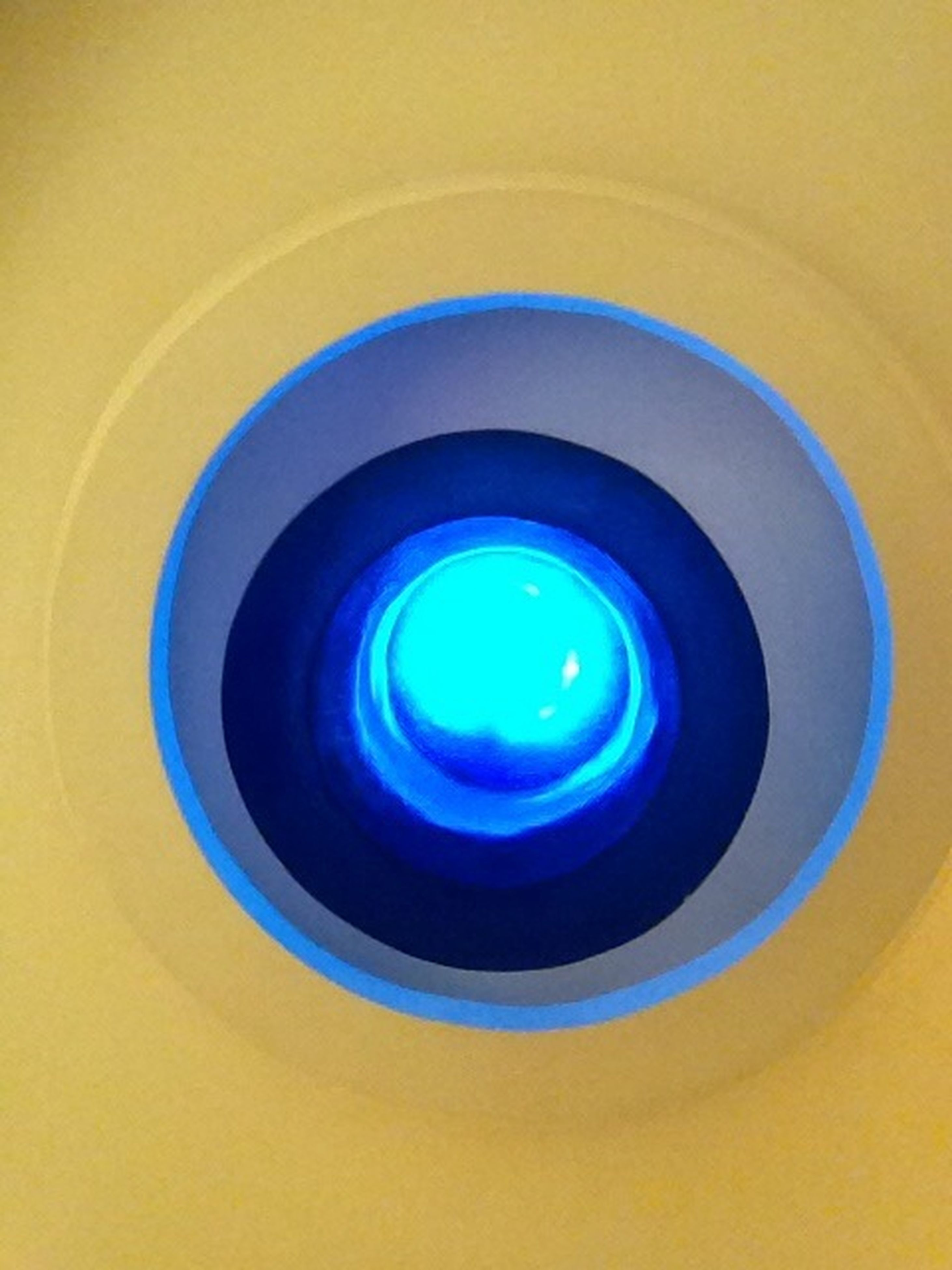 circle, blue, indoors, geometric shape, multi colored, pattern, backgrounds, illuminated, abstract, close-up, low angle view, full frame, no people, reflection, shape, modern, yellow, built structure, architecture, design