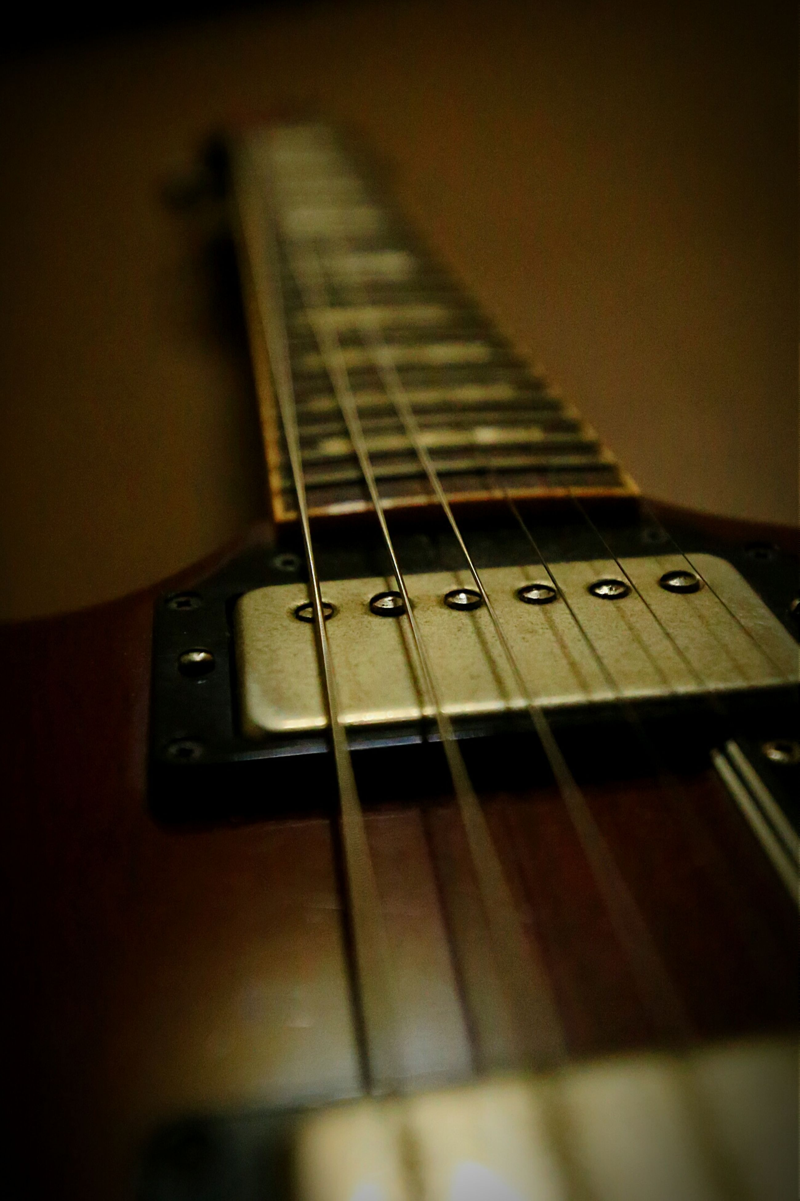 music, indoors, musical instrument, arts culture and entertainment, musical equipment, guitar, musical instrument string, piano key, technology, piano, close-up, selective focus, string instrument, acoustic guitar, still life, hobbies, audio equipment, wireless technology, focus on foreground, sound recording equipment