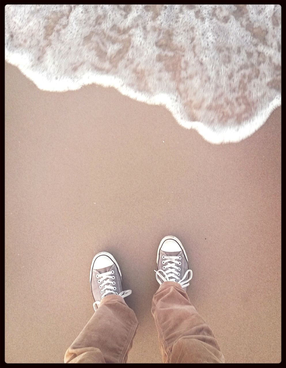 shoe, one person, low section, standing, beach, real people, human leg, sand, men, outdoors, day, human body part, water, sea, nature, one man only, people