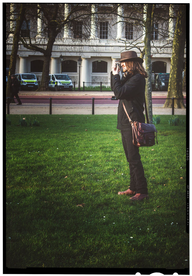 Hipster photographer Alone Bag Brown Clothes Brown Hair Casual Clothing Cool Fashionable Full Length Grass Hipster Lifestyles Men Outdoors Park Photographer Photographer In The Shot Photography Real People Relaxed