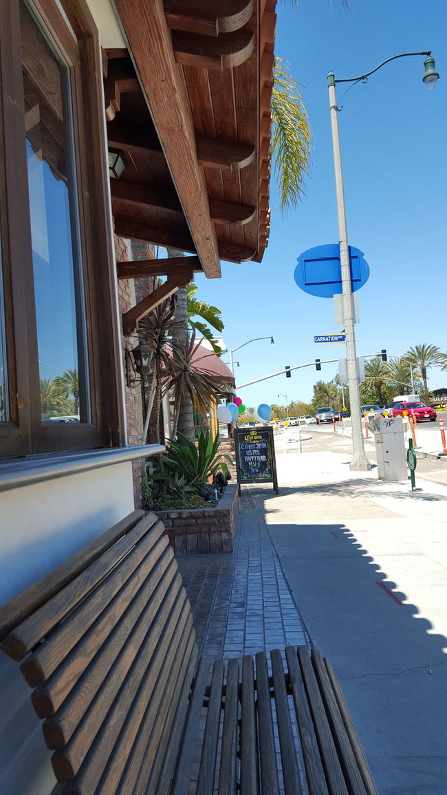 Showcase April Corona Del Mar Relaxing Bench Street Life