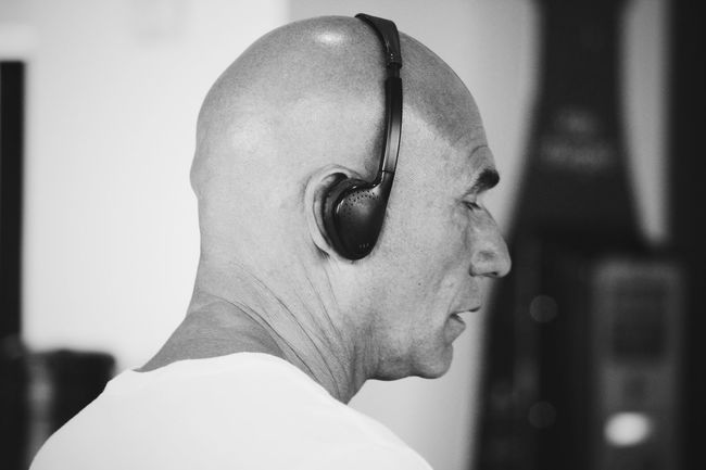 listening music on headphone Close-up Contemplation Focus On Foreground Headphones Headshot Hiding Human Face Human Mouth Listening Music Looking Music Person Selective Focus Serious Young Adult